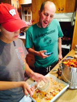 Aunt Carrie & Uncle Matt making a delicious peach crisp!