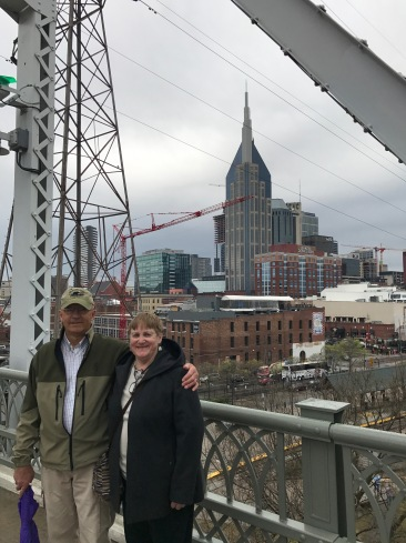 Grandpa & Grandma posing in front of the city skyline