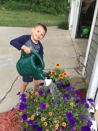Here I am, Mr. Helpful, watering mom's flowers while she was out of state for a work conference.