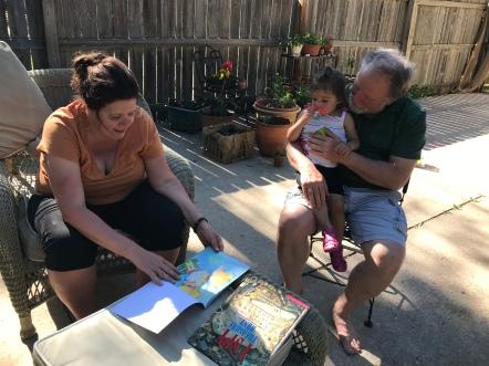 Enjoying stories in Beth's garden