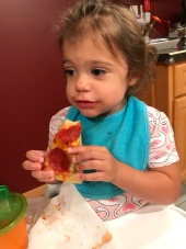 G learned how to eat full pieces of pizza