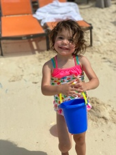 G loved her sand bucket.